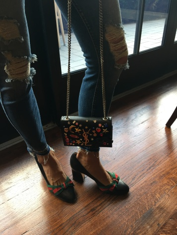 Bejewled YSL bag paired with Gucci pumps