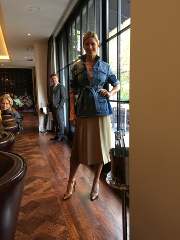 Saint Laurent denim jacket paired with a Celine pleated skirt